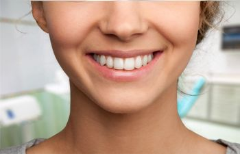 Woman Smiling After Cosmetic Dental Care at Ora Dentistry Elk Grove CA