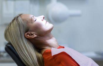 Woman in a dental chair before dental surgery.