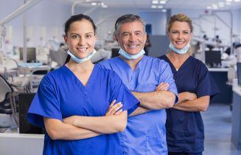 Team of doctors with medical masks.