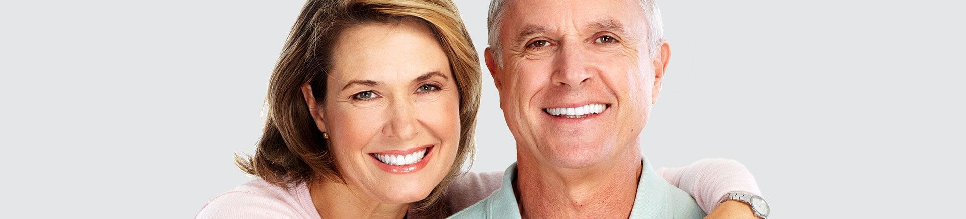 Happy elderly couple with perfect smiles.