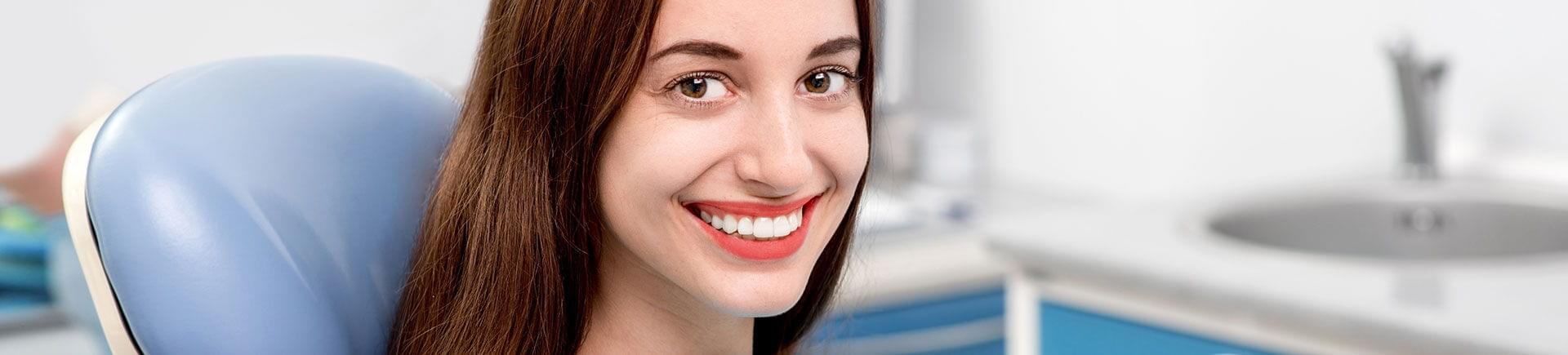 A young woman with a perfect smile after Clear Correct treatment.