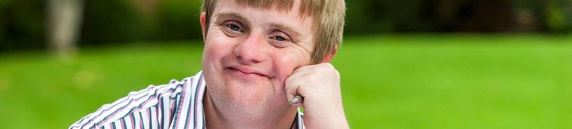 A teenage boy with Down syndrome.