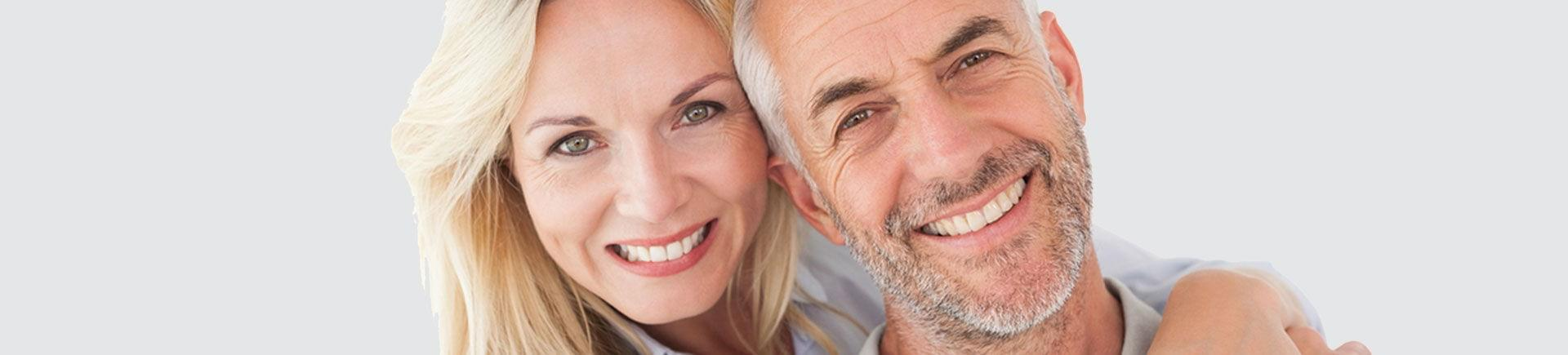 Happy mature couple with perfect smiles.