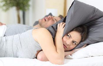 Woman in Bed With Snoring Partner Elk Grove CA
